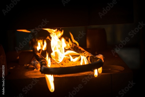 canvas print picture Fire burning on steel