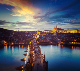Night view of Prague castle and Charles Bridge over Vltava