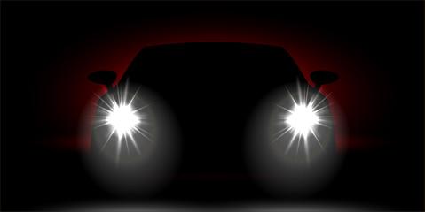 car headlights shining in the dark