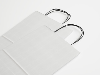 Two white paper bags with handles