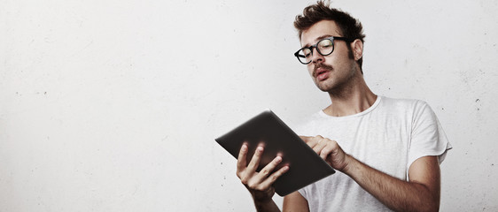 Young hipster with digital tablet