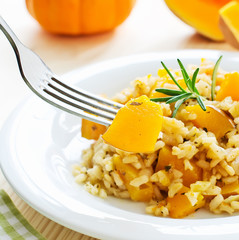 Pumpkin risotto with rosemary with a piece of vegetable on fork