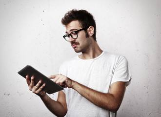 Young man with mustache use digital tablet
