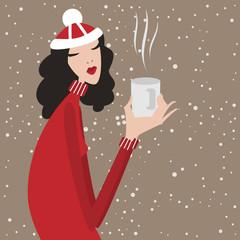 Merry Christmas. Young woman drinking tea. Christmas dress.