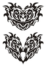 Two black demonic monsters hearts in tribal style