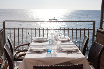 empty restaurant table by the sea
