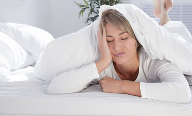 young woman in bed in the morning, not enough sleep.