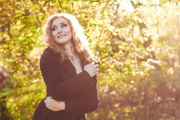 young blonde  woman  in park in autumn