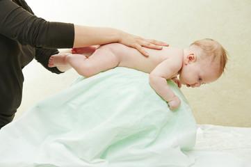Masseur massaging a child
