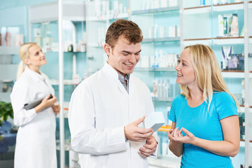 Pharmacy chemist and woman in drugstore