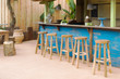 Wooden bar with bar stools - 72871113