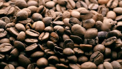 Falling coffee beans background. Sliding camera