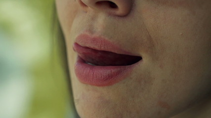 Close up of woman face licking lips