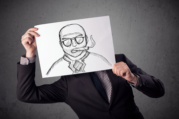 Businessman holding a cardboard with a smoking man on it in fron