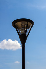 Close up of outdoor lamp with blue sky