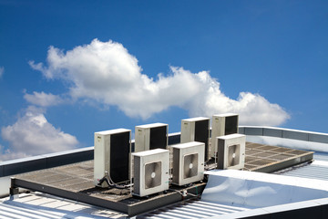 air condition outdoor unit, on the roof with blue sky