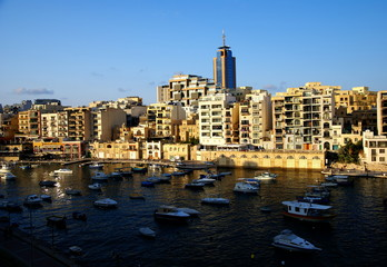 Sunset over the buildings of Malta Coast