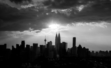 Silhouette of Kuala Lumpur city during sunset in black and white