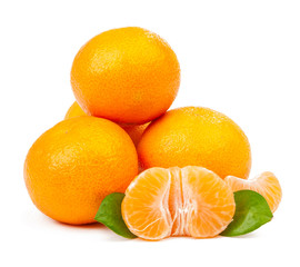 pile of tangerine and one peeled with leaves isolated