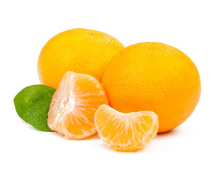 two tangerines and a few slices with leaves isolated