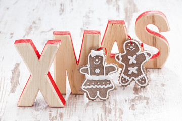 decorative wooden letters xmas on white background, gingerbread