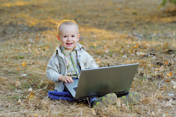 A Happy Boy and a Laptop
