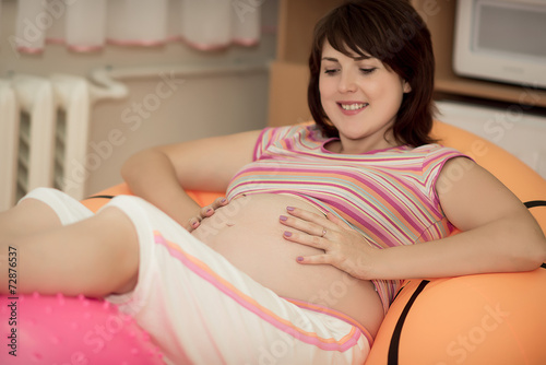 poster of Pregnant woman in childbirth. Pregnant woman with gymnastic ball