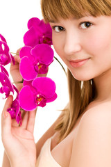 Girl with orchid sitting in studio. white background