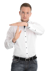 Isolated man making timeout sign with hands.