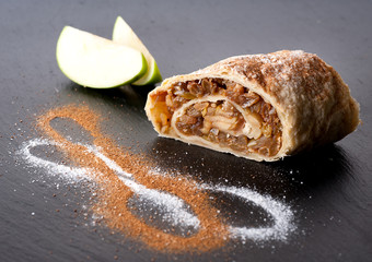 Apple strudel on a stone blackboard