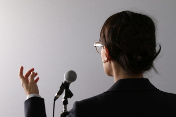 Businesswoman giving a presentation or speech