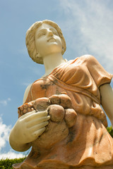 Marble statue of woman in the park