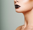 Beautiful female lips with black lipstick