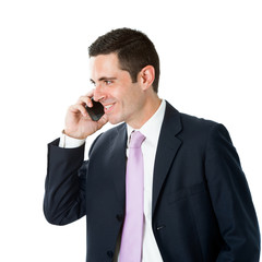 Young business man in suit talking on smart phone.