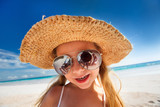 Fototapety Adorable little girl at beach