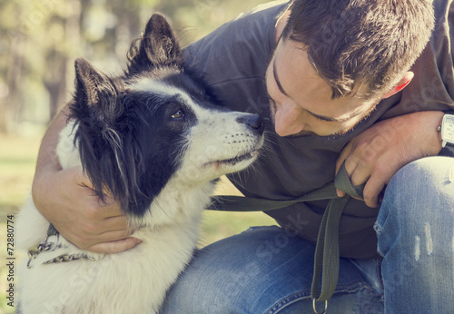 Man with his dog - 72880774