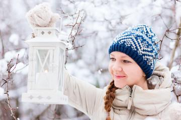 Young woman with Christmas lantern
