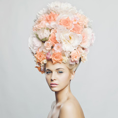 Beautiful woman with hairstyle of flowers