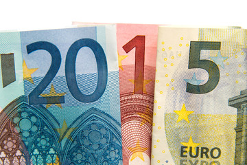 CLose up on 2015 written with euros bank notes