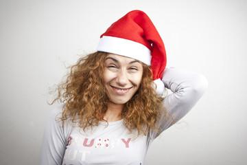 Tired sleepy woman waking up happy with xmas santa hat