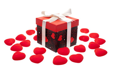 gift box with heart ornaments over white background