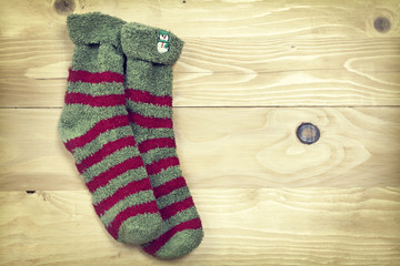 Christmas socks on rustic wooden background