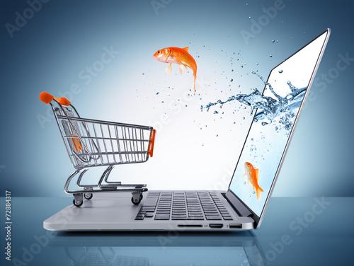 Leinwandbild Motiv goldfish in cart - e-commerce concept