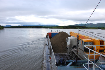 Cargo ship at Kolyma river Russia outback