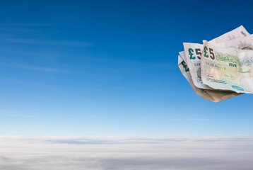 Bank notes floating in a blue sky