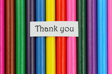 Thank you card on background made of colorful pencils