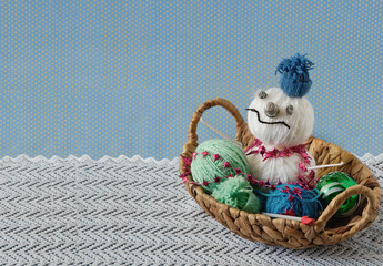 Snowman in the basket with balls of yarn