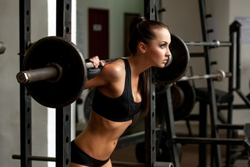 Image of beautiful slim girl lifting weight