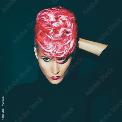 Sensual portrait lady with fashionable haircut colored hair on a - 72886783