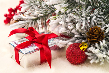 Christmas gifts and decorations on the background of fir branche